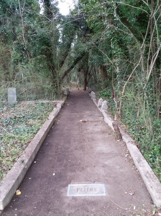 A walkway in Evergreen Cemetery in need of restoration work
