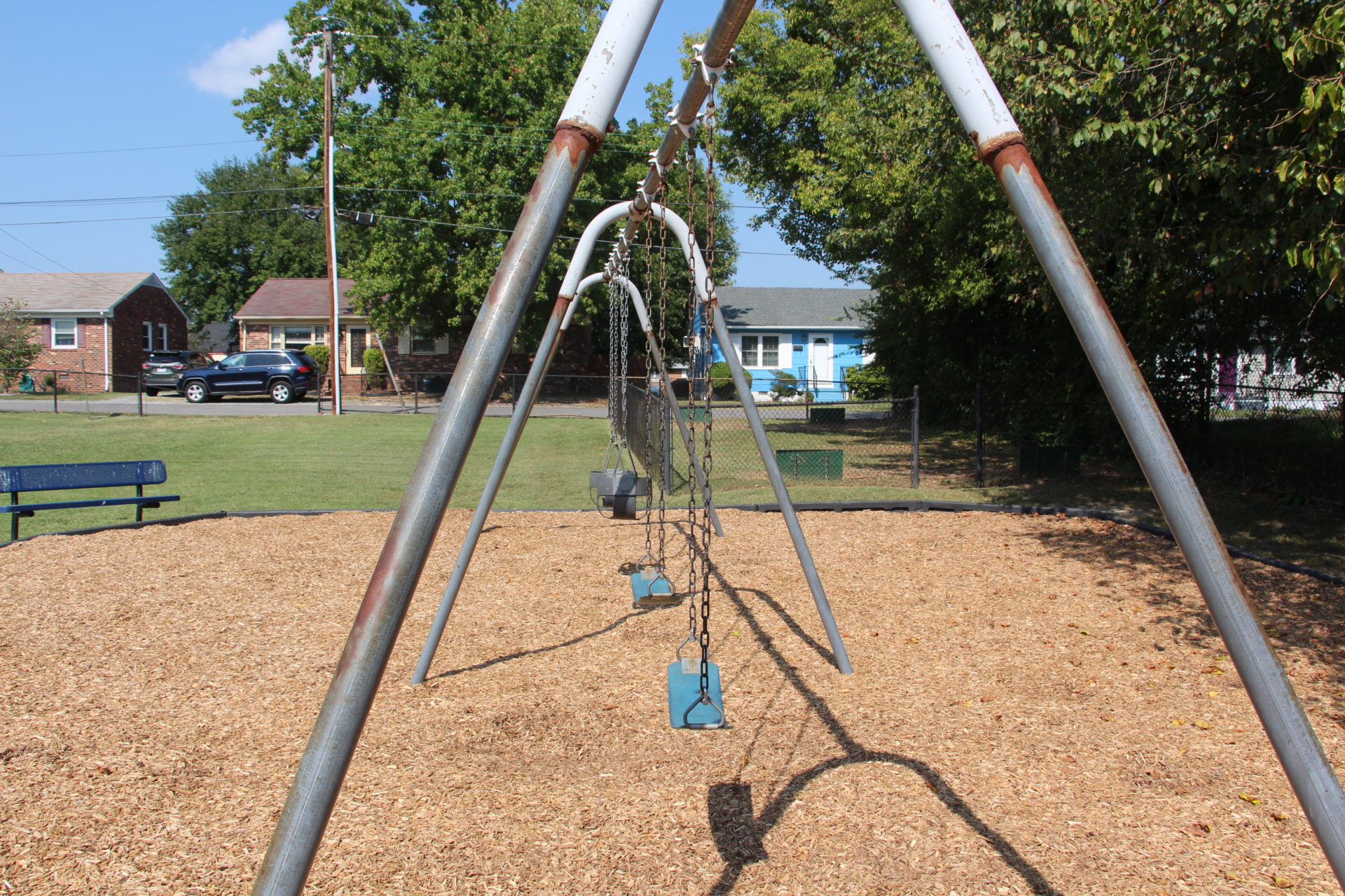 A set of playground swings.